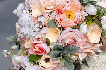 A bouquet of flowers featuring a variety of roses and other decorative flowers