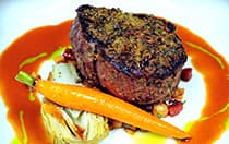 Steak, carrots and vegetables on a plate