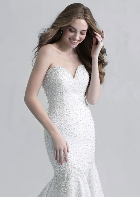 A woman in the Ariel wedding gown from the 2021 Disney Fairy Tale Weddings Platinum Collection