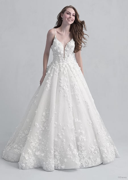 A woman dressed in the Snow White wedding gown from the 2021 Disney Fairy Tale Weddings Platinum Collection