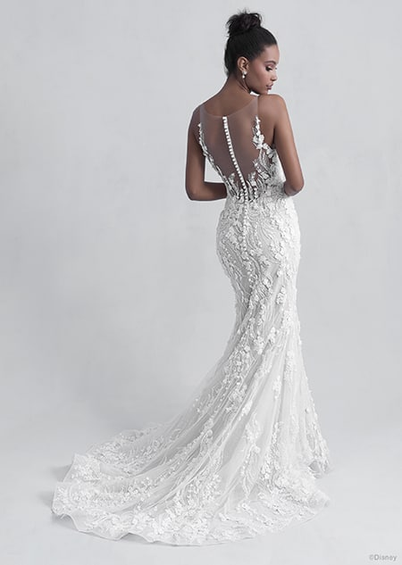 A back side view of a woman in the Tiana wedding gown from the 2021 Disney Fairy Tale Weddings Platinum Collection