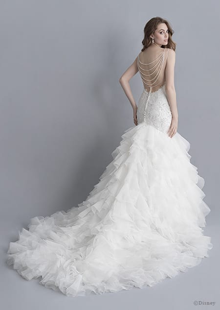 A back side view of a woman wearing the Ariel wedding gown from the 2020 Disney Fairy Tale Weddings Platinum Collection