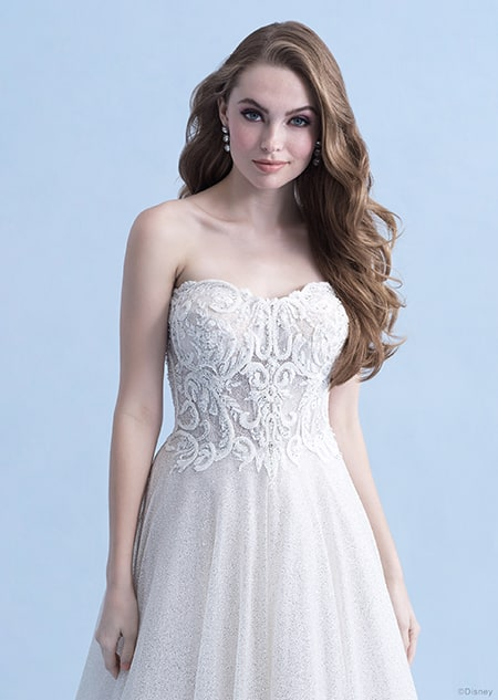 A woman in the Cinderella wedding gown from the 2021 Disney Fairy Tale Weddings Collection