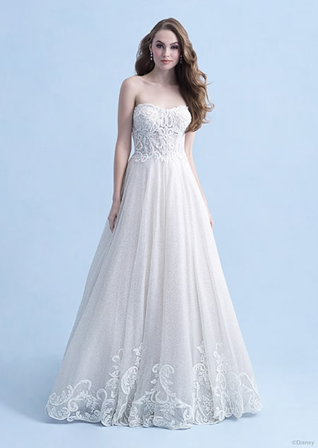 A woman wearing the Cinderella wedding gown from the 2021 Disney Fairy Tale Weddings Collection