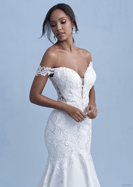 A woman in the Jasmine wedding gown from the 2021 Disney Fairy Tale Weddings Collection