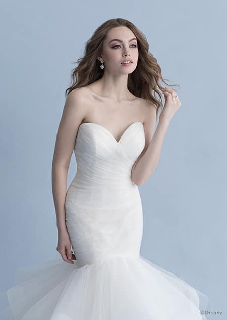A woman wearing the Ariel wedding gown from the 2020 Disney Fairy Tale Weddings Collection