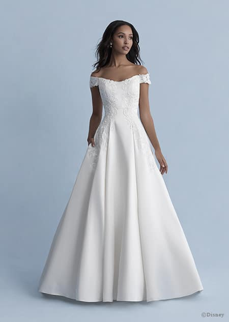 A woman wearing the Belle wedding gown from the 2020 Disney Fairy Tale Weddings Collection
