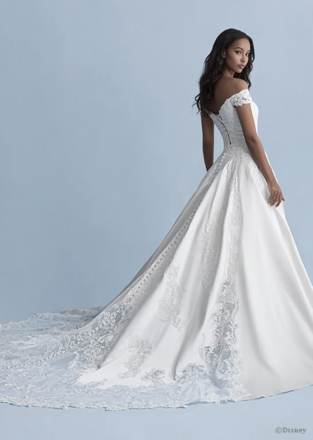 A back side view of a woman wearing the Belle wedding gown from the 2020 Disney Fairy Tale Weddings Collection