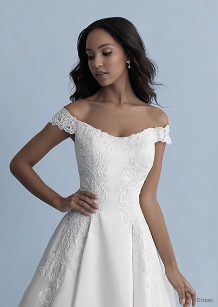 A woman in the Belle wedding gown from the 2020 Disney Fairy Tale Weddings Collection