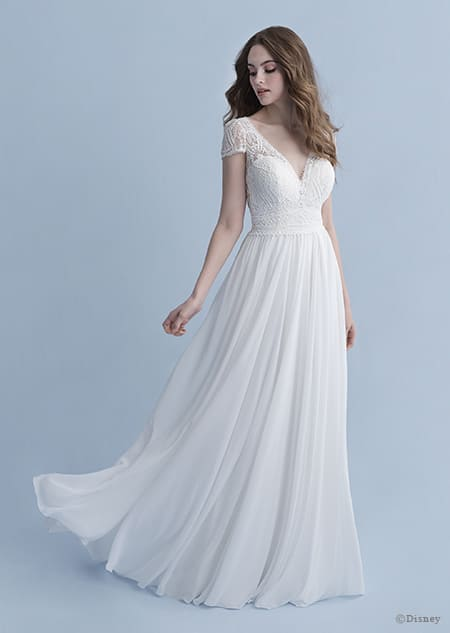 A woman in the Rapunzel wedding gown from the 2020 Disney Fairy Tale Weddings Collection