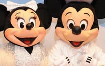 Mickey and Minnie Mouse dressed up for a party
