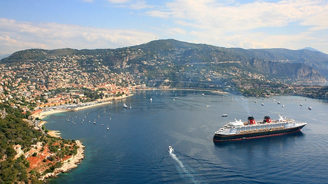 A Disney Cruise Line ship close to shore on the Mediterranean Sea