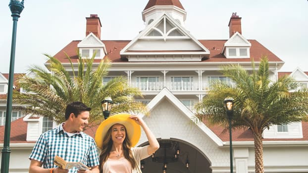 A couple walks outside Disney's Grand Floridian Resort & Spa at Walt Disney World Resort in Florida
