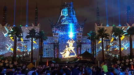 Guests watch the Star Wars Galactic Spectacular in front of the Grauman's Chinese Theatre that has state of the art effects of Darth Vader, Princess Leia and Luke Skywalker projected on its exterior